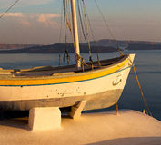 sunset boat in europe greece santorini island hill  and rocks on Stock Photography