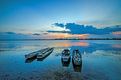 Sunset and Boat fisher. In The Lake at Surin in Thailand royalty free stock photography