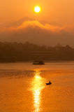 Sunset and boat with floating house Royalty Free Stock Photography