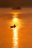 Sunset and boat with floating house Stock Photo