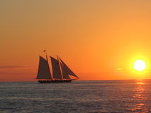 Sunset boat at key west Stock Image