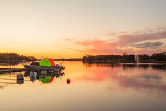 Sunset with boat on a lake near the Swedish town of Ryd Royalty Free Stock Image