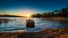 Sunset with the boat and lake, timelapse. 4k stock video footage