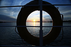 Sunset on the boat lifebuoy on board Stock Image