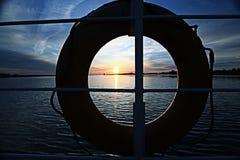 Sunset on the boat lifebuoy on board Stock Image