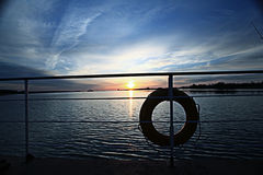 Sunset on the boat lifebuoy on board Royalty Free Stock Images