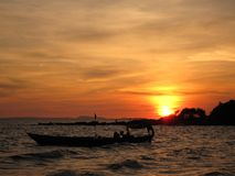 Sunset boat. Sunset and a boat in the ocean royalty free stock images