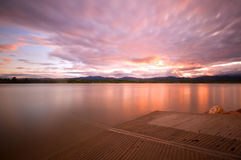 Sunset on the boat ramp. Sunset on a Colorado Lake with a boat dock stock photos