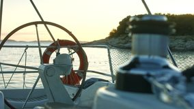 Sailor`s point of view. Sailing near coast. Sunset on a boat. Sailor`s point of view