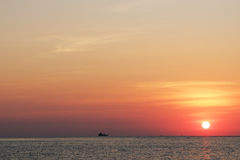 Sunset. Boat on the sea with red sky, sunset, East of Thailand Royalty Free Stock Photo