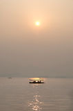 Sunset and boat silhouette, West Lake, Hangzhou Stock Photography