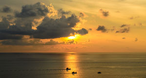 Sunset and boat take photo from Promthep cape in Phuket Royalty Free Stock Photo