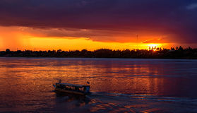 The sunset of Boat thailand. On Mekong River,Thailand Royalty Free Stock Photography