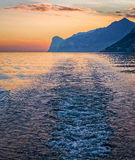 Sunset Boat Wake on Lake Garda Stock Photo