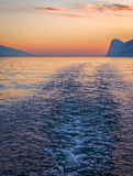 Sunset Boat Wake on Lake Garda Royalty Free Stock Photos