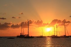 Sunset with boats Stock Photos