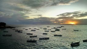 Sunset and boats. Beautiful sunset at the seaside with boats on the water surface in Salvador Stock Images