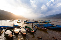 Sunset with boats at Fewa lake Stock Images