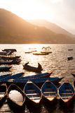 Sunset with boats at Fewa lake Stock Photos