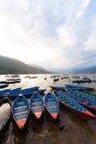 Sunset with boats at Fewa lake Stock Image