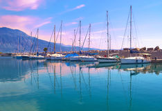 Sunset boats reflection at Kalamata Greece Stock Photo