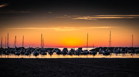 Sunset. Boats in sea harbor at sunset .Vada,Italy Royalty Free Stock Image