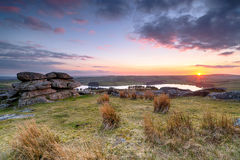 Sunset on Bodmin Moor. Sunset over Bodmin Moor in Cornwall, from Tregarrick Tor above Siblyback lake Stock Photos