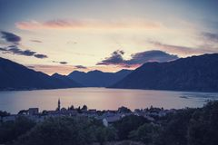 Sunset at Boka Kotorska bay. With majestic clouds, vintage travel landscape, Dobrota, Montenegro Royalty Free Stock Photography