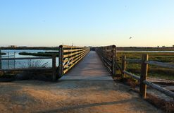 Sunset at bolsa chica wetlands through a wooden bridge Royalty Free Stock Photo