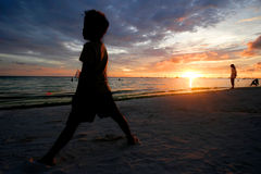 Sunset in boracay. Sunset with child on boracay beach Stock Photography