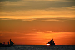 Sunset in Boracay with a boat in the foreground. Sunset in Boracay, Philippines with a boat in the foreground royalty free stock photos