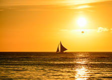 Sunset in Boracay with a boat in foreground Stock Images