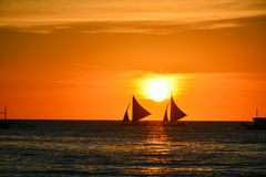 Sunset in Boracay, Philippines. With a boat in the foreground stock images