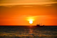 Sunset in Boracay, Philippines. With a boat in the foreground stock photos