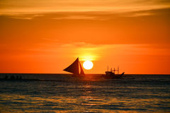 Sunset in Boracay, Philippines. With a boat in the foreground stock image
