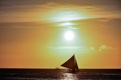 Sunset in Boracay, Philippines with a boat in the foreground Royalty Free Stock Photos