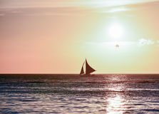 Sunset in Boracay, Philippines with a boat in foreground Royalty Free Stock Images