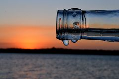 Sunset and a bottle 1 royalty free stock image