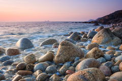 Sunset on a boulder beach Stock Photo
