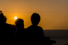 Sunset boys stock photography