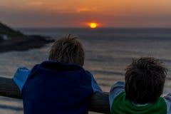 Sunset boys royalty free stock photography