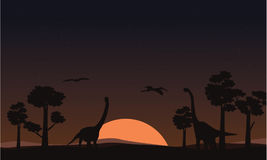 At sunset brachiosaurus landscape of silhouettes royalty free illustration
