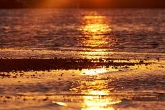 Sunset in Branden, Salling, Denmark. Reflection in the water from the sun at sunset in Salling, Denmark Royalty Free Stock Photo