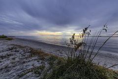 Stormy Sunset At Edisto Beach. Sunset breaking through the storm clouds at Edisto Beach, South Carolina Stock Image