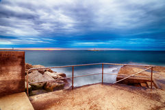 Sunset on breakwater with stairs Royalty Free Stock Photography