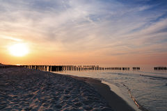 Sunset and breakwaters on the Baltic Sea Stock Image