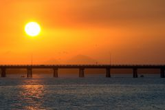 Sunset at Bribie Island. The sun goes down over a bridge Stock Image