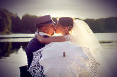 Sunset, the bride to the groom kiss Stock Image