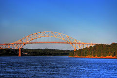 Sunset Bridge. The Bourne Bridge over the Cape Cod canal at sunset Royalty Free Stock Image