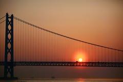 Sunset on the bridge. Sunset on the Akashi-Kaikyo strait bridge at Kobe, Japan. Akashi brdige, also known as the Pearl Bridge, is the longest suspension bridge Royalty Free Stock Photos